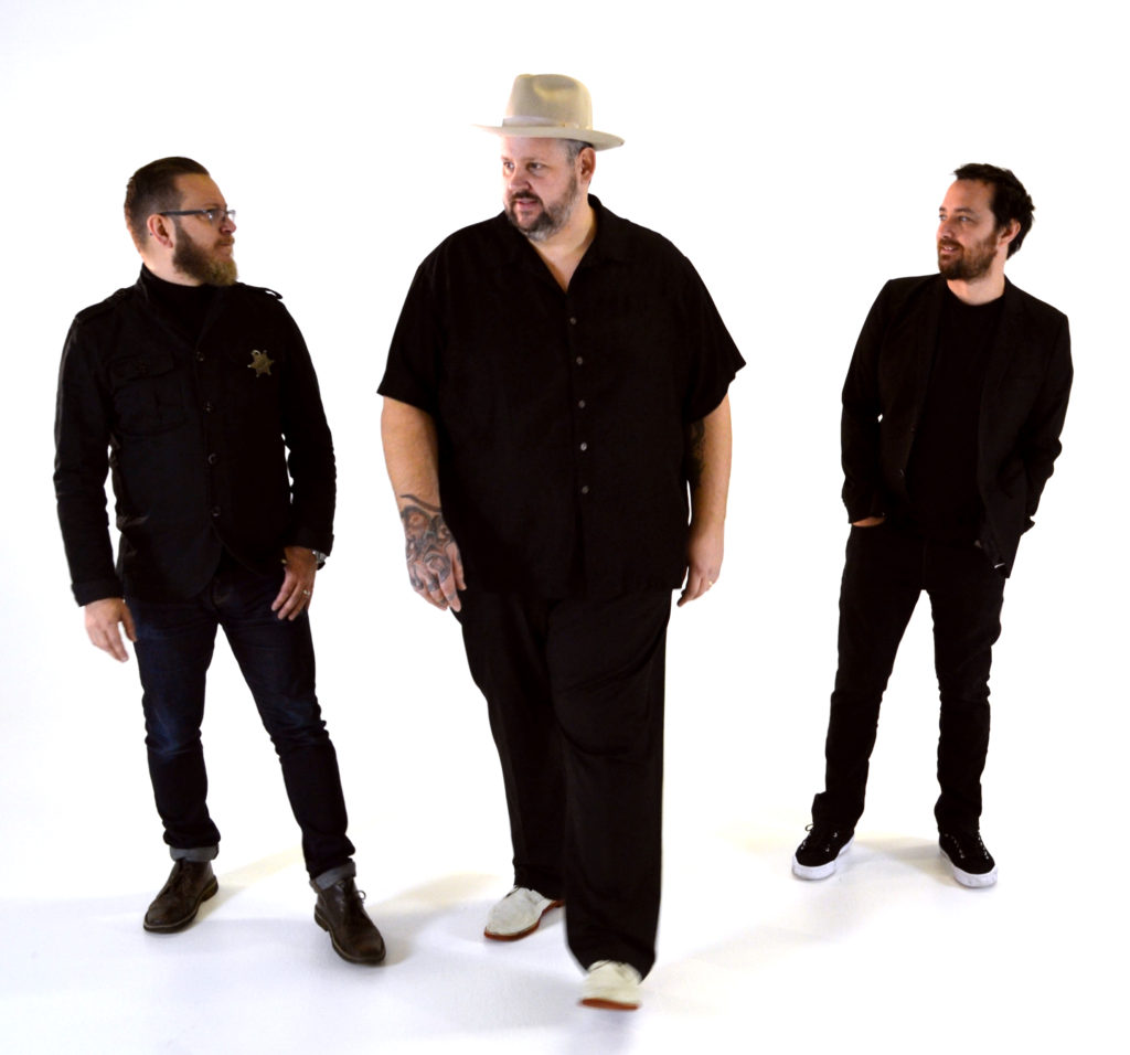 image of Big Boy Bloater & The LiMiTs dressed in black with a white background